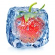 Strawberry in ice with drops — Stock Photo
