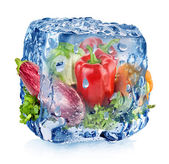 Ice cube with vegetables — Stock Photo