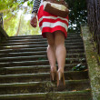 Woman walking up stairs — Stock Photo