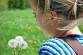 Young girl with dandelions — Stock fotografie
