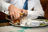 Man pouring whiskey — Stock Photo