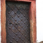 Vintage catholic church door — Stock Photo #35091929