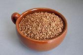 Buckwheat in ceramic bowl — Stock Photo
