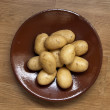 Potatoes on ceramic plate — Stock Photo