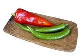 Röd och grön paprika — Stockfoto