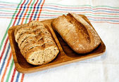 Rye bread on wooden plate — Stock Photo