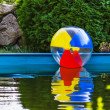 Colorful  ball floating in the pool — Stock Photo