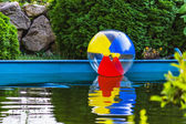 Colorful ball floating in the pool — ストック写真
