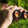 Watching with binoculars - Stock Photo