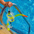 Mask and snorkel for diving near the pool - Stock Photo