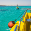 Part of fishing boat with red buoy - Stock Photo