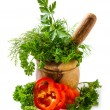 Spices and herbs in a mortar - Stock Photo