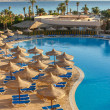 The pool, beach umbrellas and the Red Sea in Egypt — Stock Photo