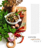 Marinated mushrooms in a cup on the background of spices — Stock Photo