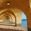 The arched stone colonnade with lanterns - Stock Photo