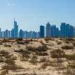 Midday heat in the desert in the background buildingsl on Nov 1 - Stock Photo