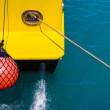 Part of fishing boat with red buoy — Stockfoto