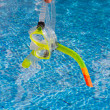Stock Photo: Mask and snorkel for diving near pool