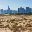 Stock Photo: Midday heat in desert in background buildingsl