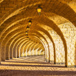Stock Photo: Arched stone colonnade with lanterns