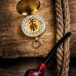 Compass and a pipe with a rope - Stock fotografie