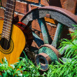 Royalty-Free Stock Photo: Guitar and the old wagon wheel
