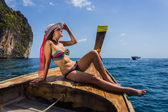 The girl in a bathing suit on a boat — Stock Photo
