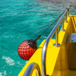 Part of fishing boat with red buoy — Stock Photo