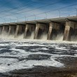 Stock Photo: Water pouring through sleus gates at dam