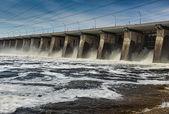 Water pouring through sleus gates at dam — Stock Photo