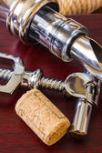 The bottle with corkscrew and wine accessories — Stock Photo