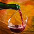 Wine pours into glass of bottle — Stock Photo #28611293