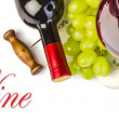 Stock Photo: Glass of red wine with bottle and grapes