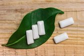 Chewing gum is on a leaf — Stock Photo