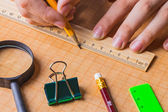 Draftsman draws on a ruler — Stock Photo
