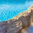 Side of pool is edged with stone — Stock Photo #30430985