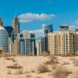 Midday heat in the desert in the background buildings — Stock Photo