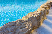 Side of pool is edged with stone — Stock Photo