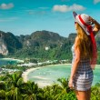 The girl at the resort in a dress on the background of the bays — Stock Photo #30909897