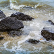 Sea surf washes over the coastal stones — Stock Photo