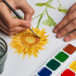 The artist paints a flower of watercolor — Stock Photo
