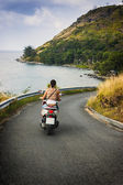 The girl riding a motorcycle in Thailand — Stock Photo
