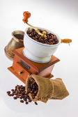 Grinder and coffee beans — Stock Photo