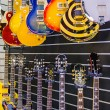 Stock Photo: Many guitars presented in music store