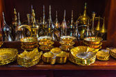 Row of shiny traditional coffee pots and lamp — Stockfoto
