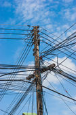 Electrical wires on poles — Stock Photo