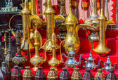 Row of shiny traditional coffee pots and lamp — Stock Photo