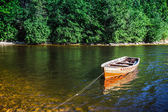 Wooden boat on the river bank — Stock Photo