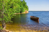 Wooden boat on the river bank — Stok fotoğraf