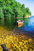 Wooden boat on the river bank — Foto Stock